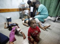 wounded children on floor in hospital