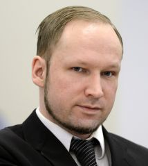 Self confessed mass murderer and right-wing extremist Anders Behring Breivik places a clenched fist on his heart in a salute as he arrive on day three in room 250 at the central court in Oslo on April 18, 2012. Anders Behring Breivik, who killed 77 people in Norway last July, took the stand again Wednesday on the third day of his trial, a day after telling the court he would carry out his attacks again if he could. AFP PHOTO / ODD ANDERSEN (Photo credit should read ODD ANDERSEN/AFP/Getty Images)