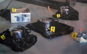 An RCMP photograph of pressure cookers they say two people intended to use as explosive devices is displayed during a news conference to announce terrorism charges in Surrey, B.C., on Tuesday, July 2, 2013. The charges are in connection to an alleged Al-Qaeda-inspired plot to explode a bomb at the B.C. Legislature on Canada Day. THE CANADIAN PRESS/Darryl Dyck