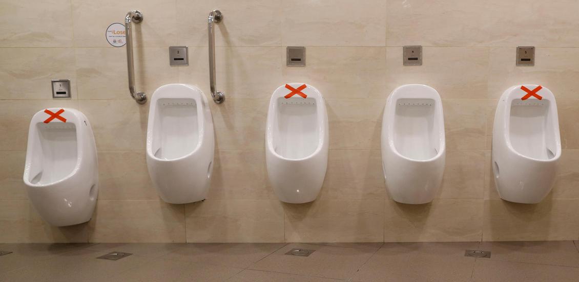 CoV distance urinals Singapore